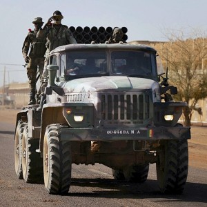 Malian soldiers drive a B-21 multiple rocket launcher vehicle in the town of Gao after returning from Bourem
